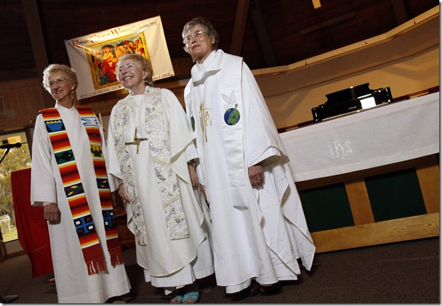 Bishop Bridget (center) and two new womenpriests